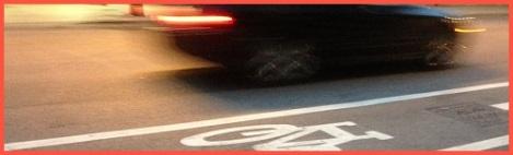 Red_bike lane and car